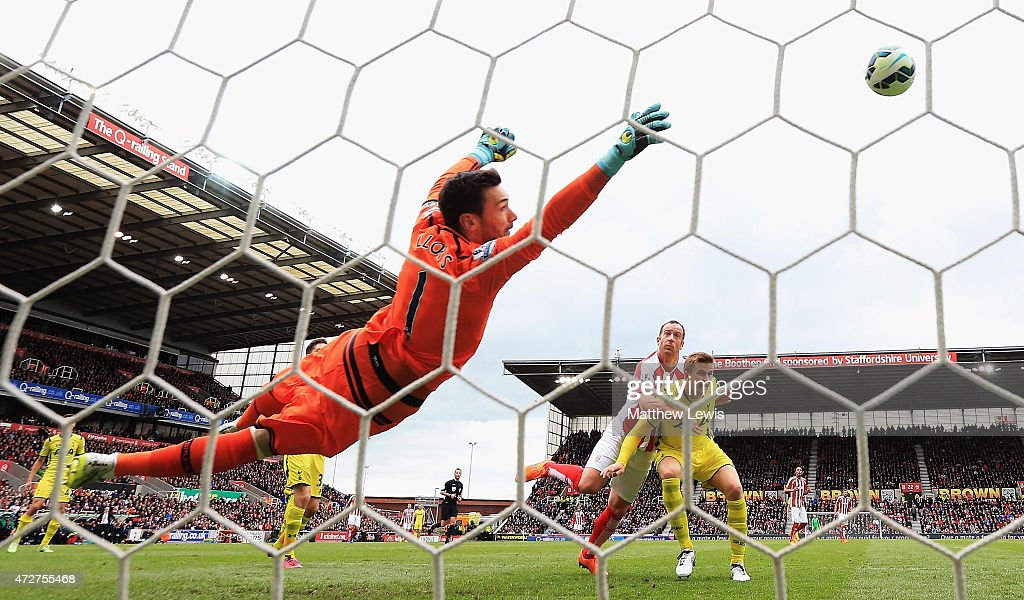 Charlie Adam of Stoke City scores the opening goal past Hugo Lloris of Tottenham Hotspur during the Barclays Premier League match between Stoke City and Tottenham Hotspur at Britannia Stadium on May 9, 2015 in Stoke on Trent, England.