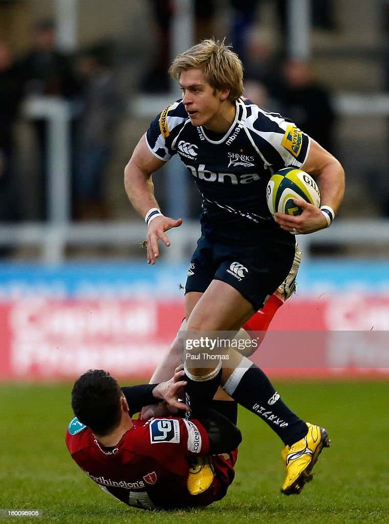 Charlie Amesbury (R) of Sale Sharks is tackled by <a gi-track='captionPersonalityLinkClicked' href=/galleries/search?phrase=Kristian+Phillips&family=editorial&specificpeople=6725918 ng-click='$event.stopPropagation()'>Kristian Phillips</a> of Scarlets during the LV= Cup match between Sale Sharks and Scarlets at Salford City Stadium on January 26, 2013 in Salford, England.
