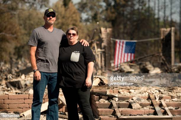 Charlie and Kate Higgins pose for a portrait in front of their burned home in Santa Rosa California on October 12 2017 Hundreds of people are still...