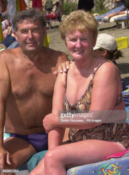 Charlie and Meg Gilbert from Aberdeen on the beach at Benalmadena on the Costa Del Sol in Spain despite a series of bomb alerts across the country in...
