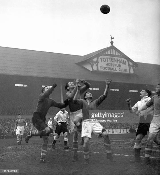 Charlie Ashcroft Liverpool goalkeeper punches clear from the Tottenham forwards