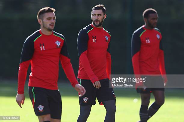Charlie Austin flanked by Dusan Tadic and Cuco Martina during the Southampton training session at Staplewood Training Ground on November 2 2016 in...