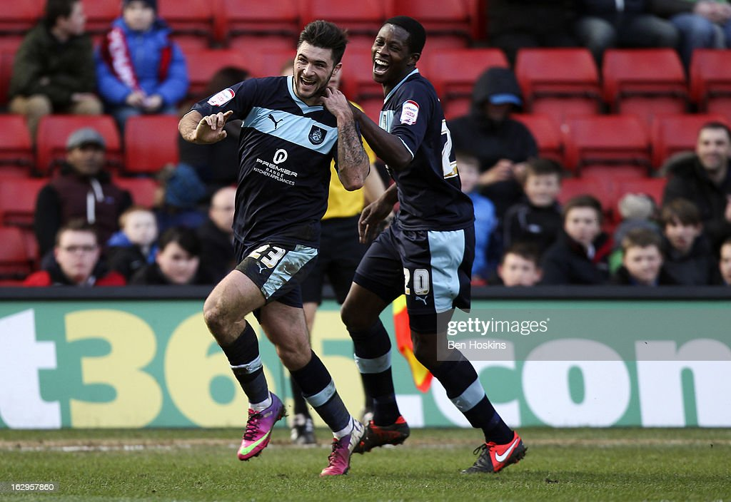 Charlie Austin of Burnley (L) celebrates with Marvin Bartley of Burnley after scoring the opening goal of the game during the npower Championship match between Charlton Athletic and Burnley at the Valley on March 02, 2013 in London, England.
