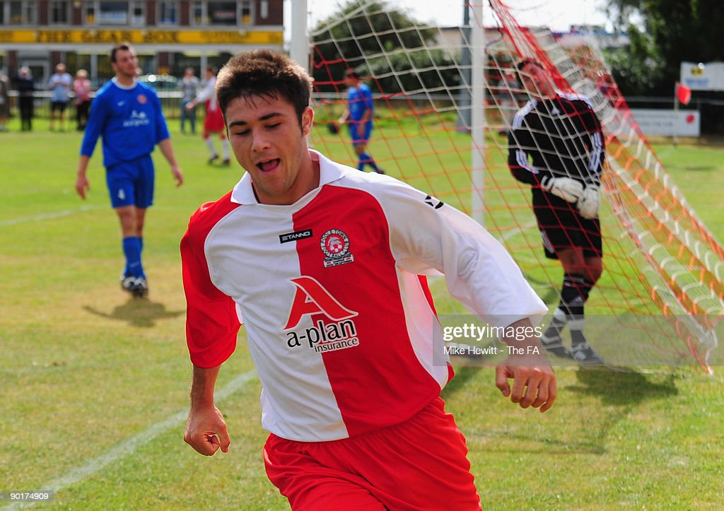 Charlie Austin of Poole Town wheels away after heading past goalkeeper Aaron Schreech of Barnstable to put his team two up during the FA Cup...