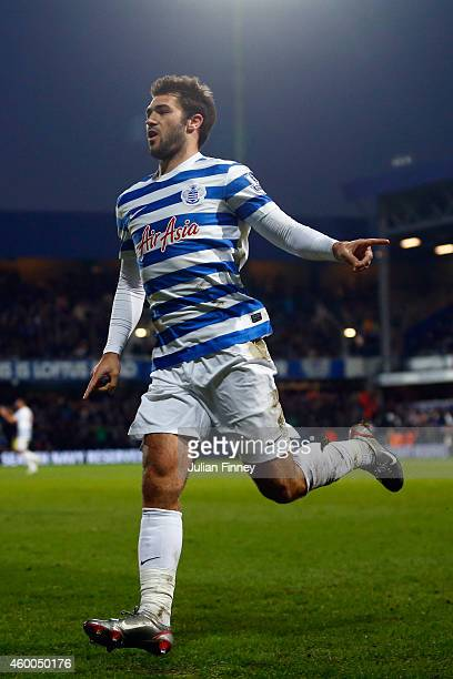 Charlie Austin of QPR celebrates scoring his team's second goal during the Barclays Premier League match between Queens Park Rangers and Burnley at...