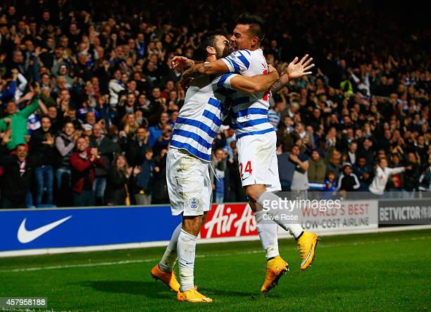 Charlie Austin of QPR celebrates scoring their second goal with Eduardo Vargas of QPR during the Barclays Premier League match between Queens Park...