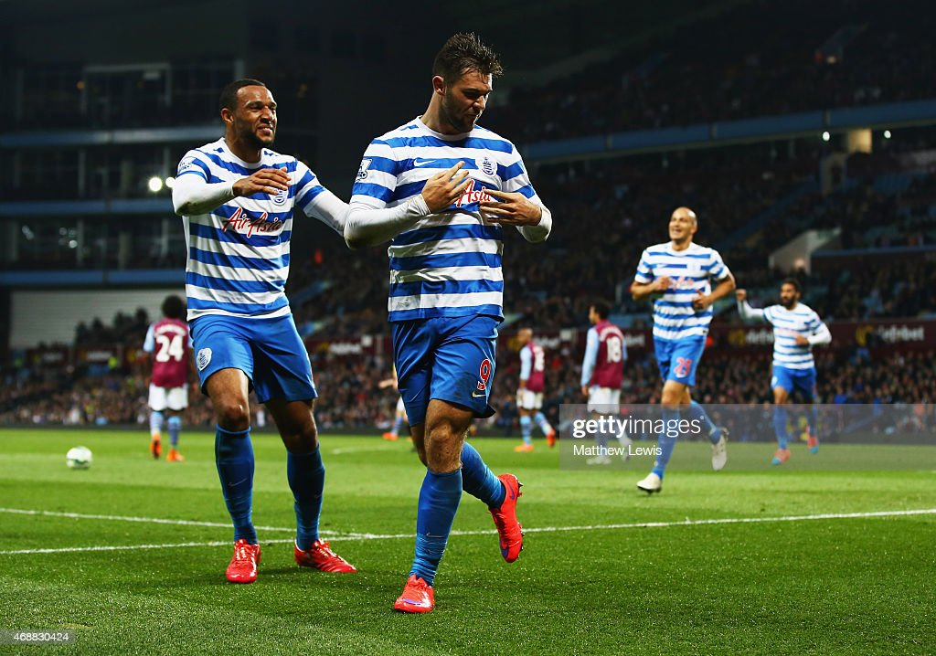 Charlie Austin of QPR (9) celebrates with Matt Phillips as he scores their third goal during the Barclays Premier League match between Aston Villa and Queens Park Rangers at Villa Park on April 7, 2015 in Birmingham, England.