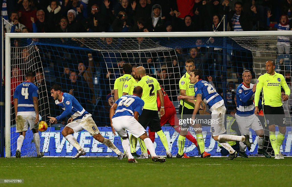 Charlie Austin of QPR (2L) scores his second goal during the Sky Bet Championship match between Queens Park Rangers and Brighton and Hove Albion at Loftus Road on December 15, 2015 in London, United Kingdom.