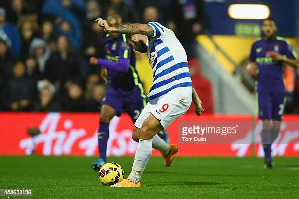 Charlie Austin of QPR scores their first goal during the Barclays Premier League match between Queens Park Rangers and Manchester City at Loftus Road...