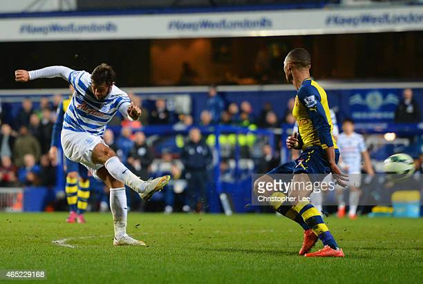 Charlie Austin of QPR shoots past Kieran Gibbs of Arsenal to score their first goal during the Barclays Premier League match between Queens Park...