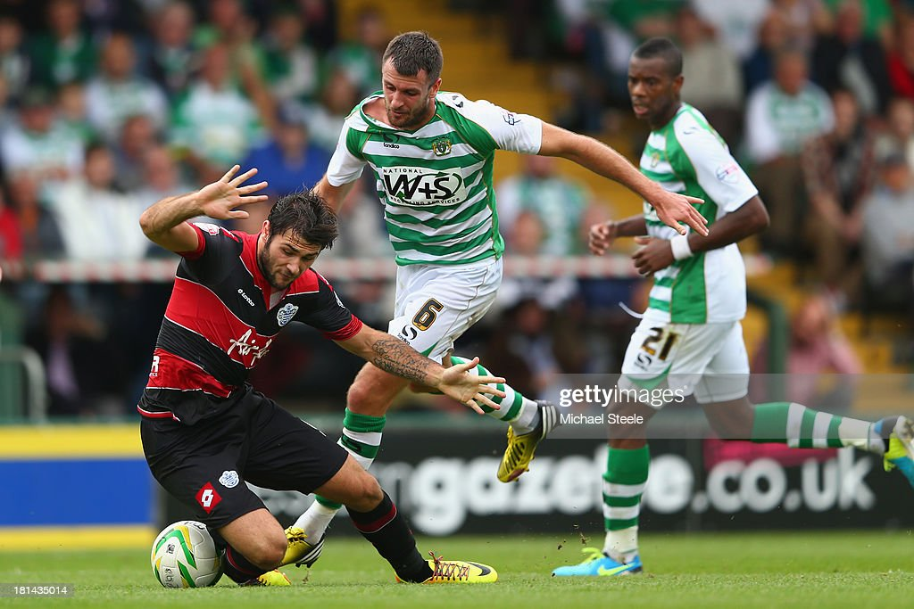 Charlie Austin of Queens Park Rangers is fouled by Daniel Seaborne of Yeovil Town and concedes a penalty during the Sky Bet Championship match...