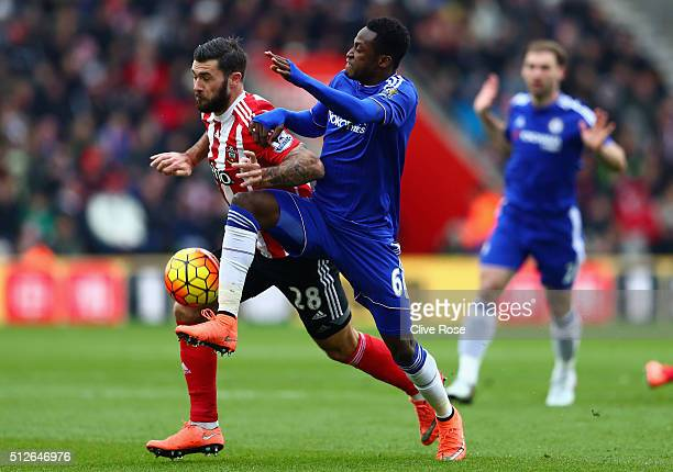 Charlie Austin of Southampton and Baba Rahman of Chelsea compete for the ball during the Barclays Premier League match between Southampton and...