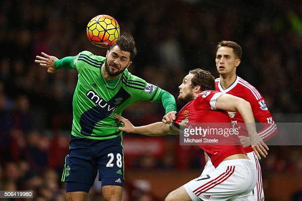Charlie Austin of Southampton and Daley Blind of Manchester United compete for the ball during the Barclays Premier League match between Manchester...