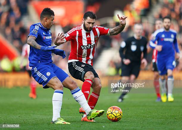 Charlie Austin of Southampton and Kenedy of Chelsea compete for the ball during the Barclays Premier League match between Southampton and Chelsea at...