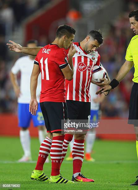 Charlie Austin of Southampton argues with teammate Dusan Tadic over who takes the penalty during the UEFA Europa League Group K match between...