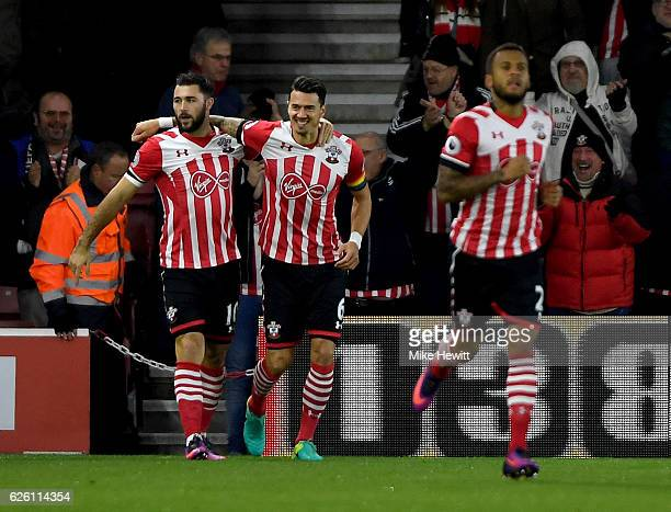 Charlie Austin of Southampton celebrates scoring his sides first goal with Jose Fonte of Southampton during the Premier League match between...
