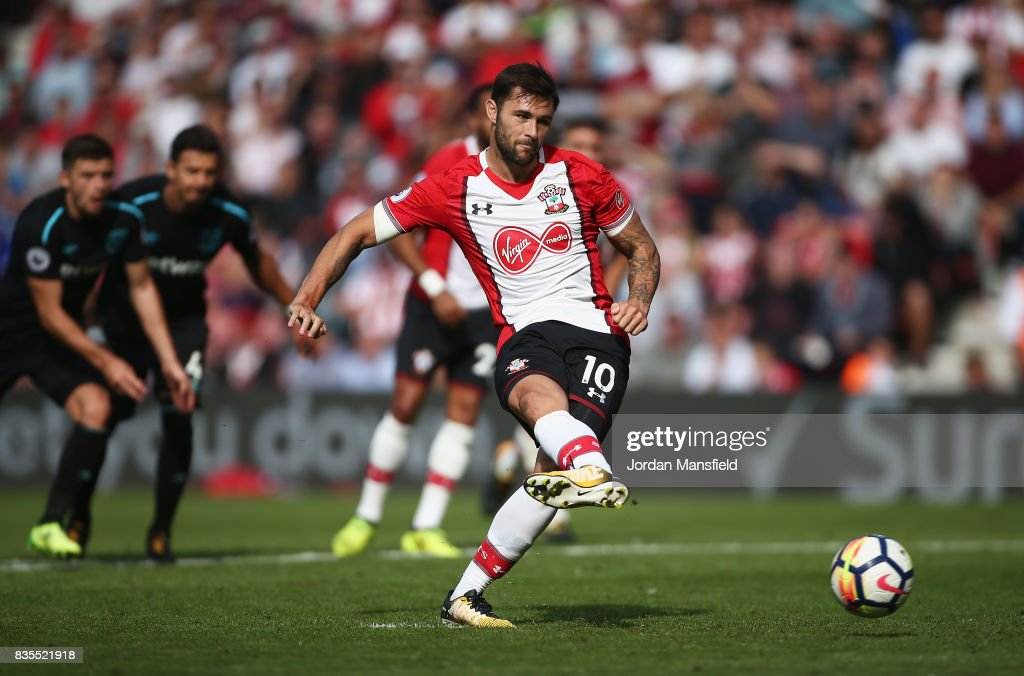 Charlie Austin of Southampton celebrates scoring his sides third goal from the penalty spot during the Premier League match between Southampton and West Ham United at St Mary's Stadium on August 19, 2017 in Southampton, England.
