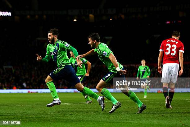 Charlie Austin of Southampton celebrates scoring his team's first goal with his team mate Shane Long during the Barclays Premier League match between...