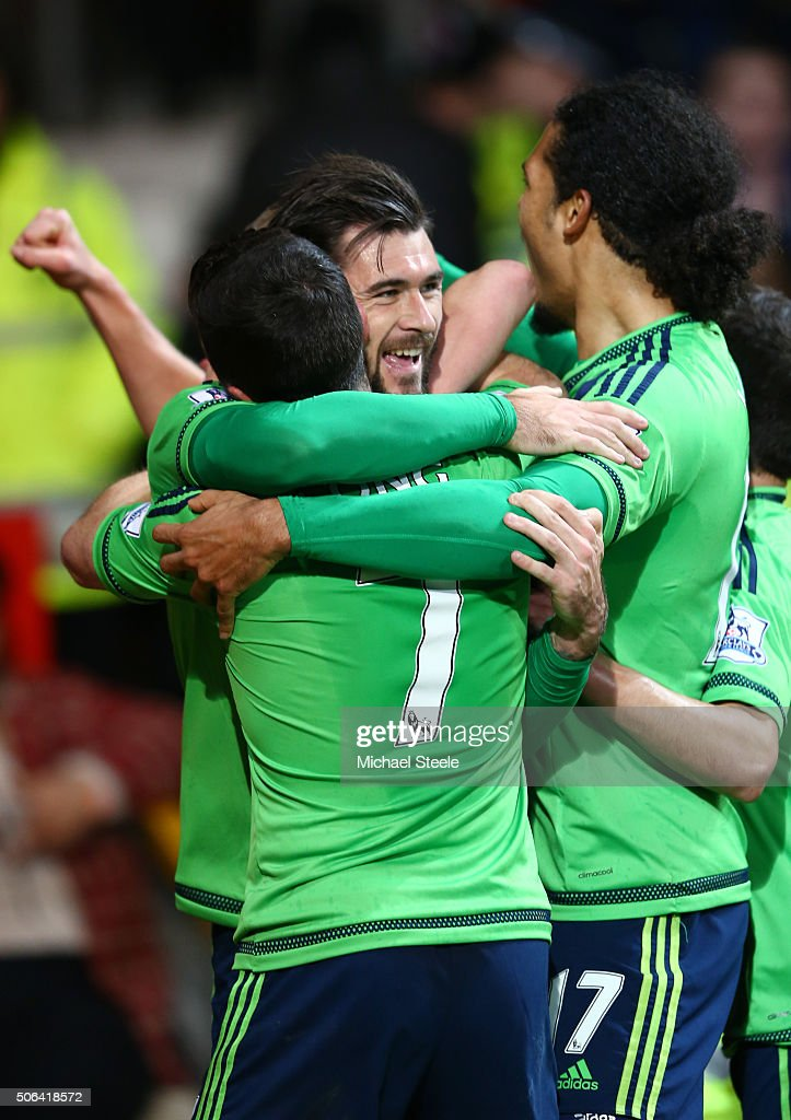 Charlie Austin (C) of Southampton celebrates scoring his team's first goal with his team mates Shane Long (L) and Virgil van Dijk (R) during the Barclays Premier League match between Manchester United and Southampton at Old Trafford on January 23, 2016 in Manchester, England.