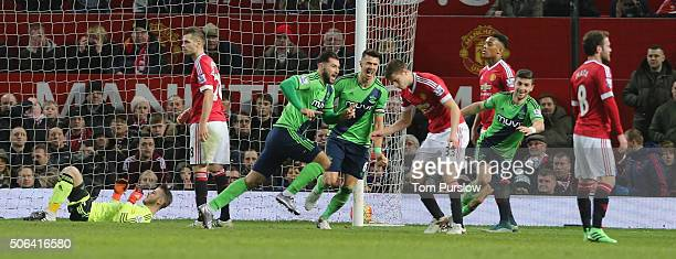 Charlie Austin of Southampton celebrates scoring their first goal during the Barclays Premier League match between Manchester United and Jose Fonte...