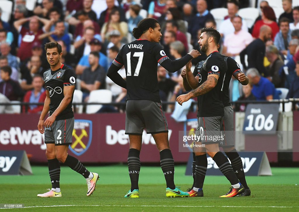 Charlie Austin of Southampton (10) celebrates with Virgil van Dijk (17) as he scores their first goal during the Premier League match between West Ham United and Southampton at London Stadium on September 25, 2016 in London, England.