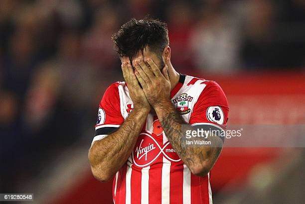 Charlie Austin of Southampton holds his head in his hands after missing a chance during the Premier League match between Southampton and Chelsea at...