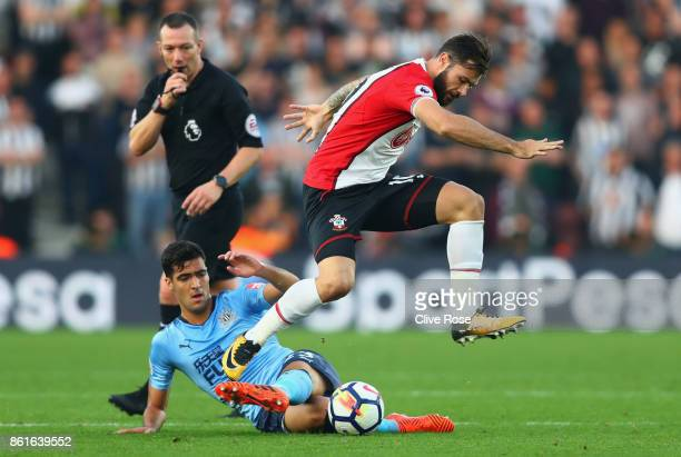 Charlie Austin of Southampton is tackled by Mikel Merino of Newcastle United during the Premier League match between Southampton and Newcastle United...