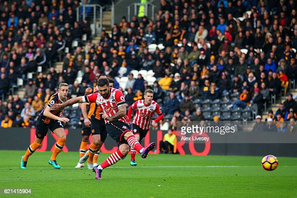 Charlie Austin of Southampton scores his sides first goal from the penalty spot during the Premier League match between Hull City and Southampton at...