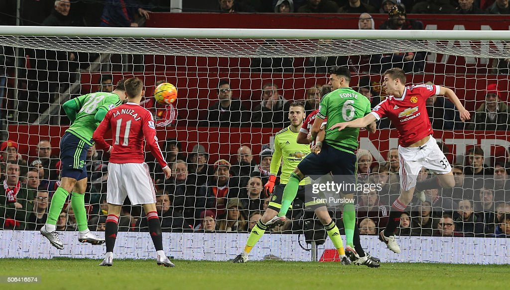 Charlie Austin of Southampton scores their first goal during the Barclays Premier League match between Manchester United and Jose Fonte at Old Trafford on January 23, 2016 in Manchester, England.
