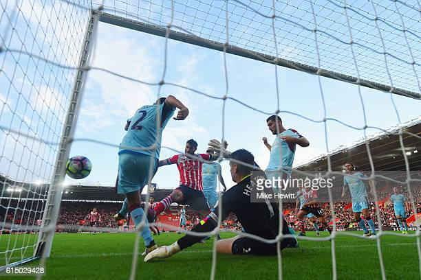 Charlie Austin of Southampton scores their first goal past goalkeeper Tom Heaton of Burnley during the Premier League match between Southampton and...