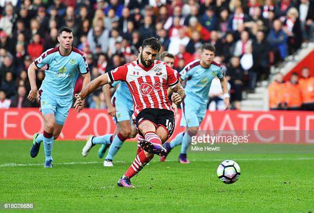 Charlie Austin of Southampton scores their third goal from the penalty spot during the Premier League match between Southampton and Burnley at St...