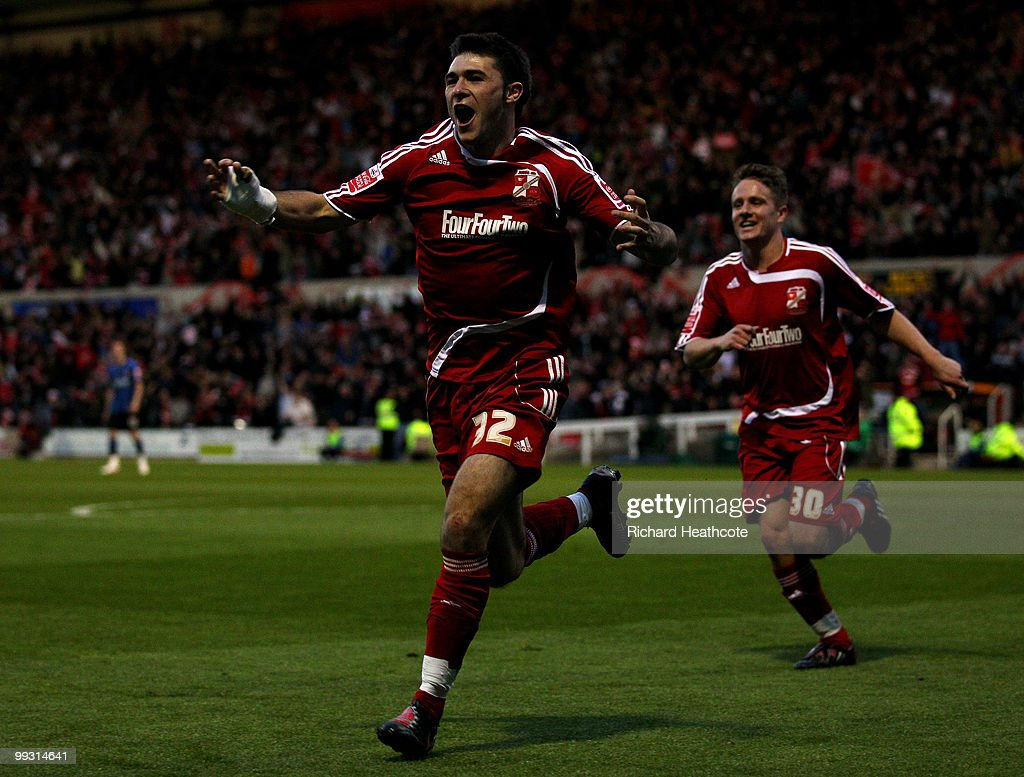 Charlie Austin of Swindon celebrates scoring the opening goal during the CocaCola League One Playoff Semi Final 1st leg match between Swindon Town...