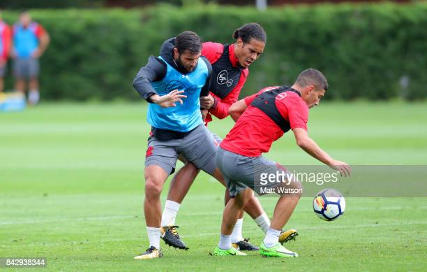 Charlie Austin Virgil Van Dijk and Jeremy Pied during a Southampton FC training session at the Staplewood Complex on September 5 2017 in Southampton...