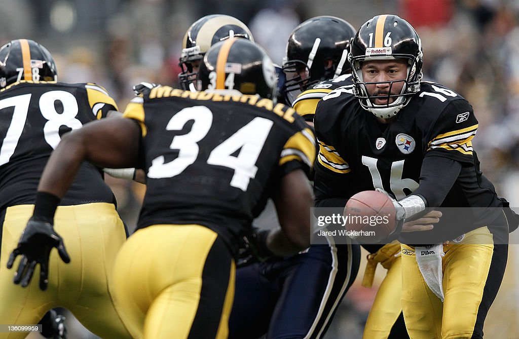 Charlie Batch #16 of the Pittsburgh Steelers hands the ball off to teammate Rashard Mendenhall #34 against the St. Louis Rams during the Christmas Eve game on December 24, 2011 at Heinz Field in Pittsburgh, Pennsylvania.