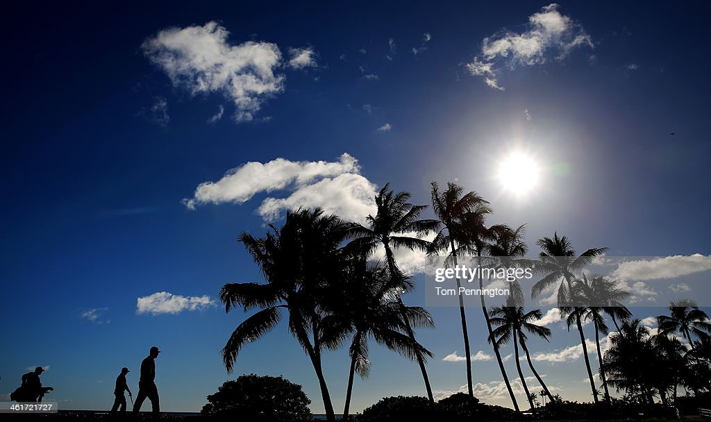 Charlie Beljan and Ted Potter Jr. walk down the 17th fairway during the second round of the Sony Open in Hawaii at Waialae Country Club on January 10, 2014 in Honolulu, Hawaii.