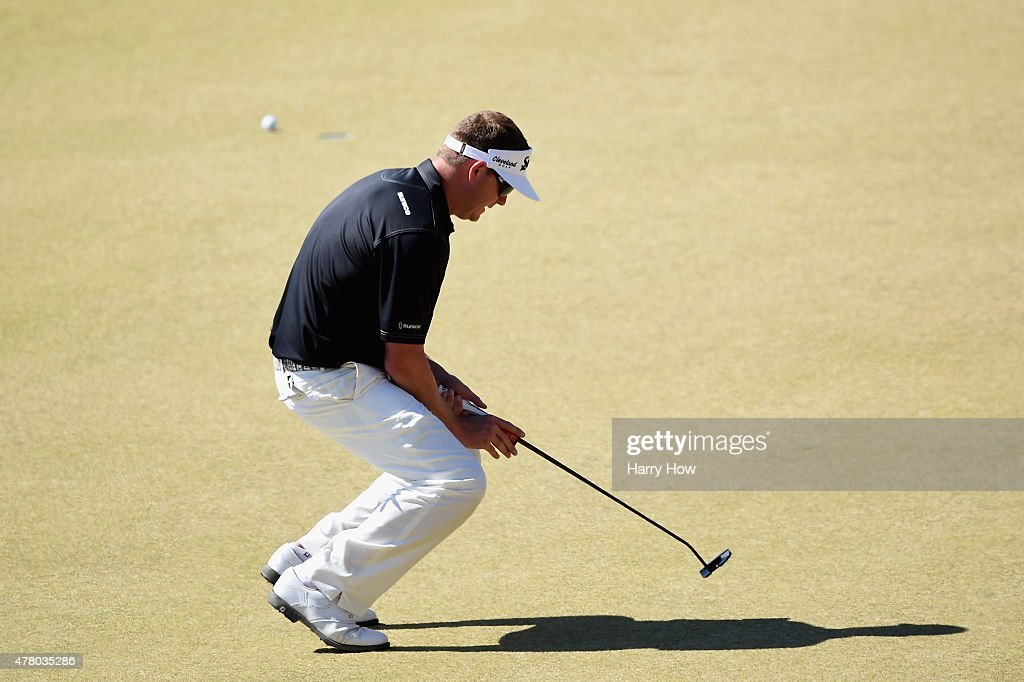 Charlie Beljan of the United States reacts to missing a putt for birdie on the 13th green during the final round of the 115th U.S. Open Championship at Chambers Bay on June 21, 2015 in University Place, Washington.