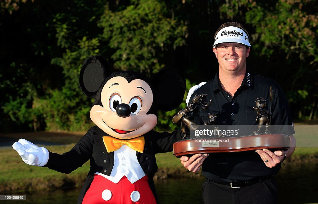 Charlie Beljan poses with the trophy and Mickey Mouse after winning the Children's Miracle Network Hospitals Classic at the Disney Magnolia course on November 11, 2012 in Lake Buena Vista, Florida.
