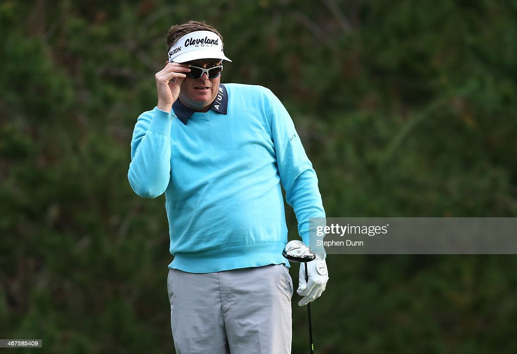 <a gi-track='captionPersonalityLinkClicked' href=/galleries/search?phrase=Charlie+Beljan&family=editorial&specificpeople=5926093 ng-click='$event.stopPropagation()'>Charlie Beljan</a> watches his shot on the ninth tee during the continuation of the first round of the AT&T Pebble Beach National Pro-Am at Spyglass Hill Golf Course on February 7, 2014 in Pebble Beach, California.