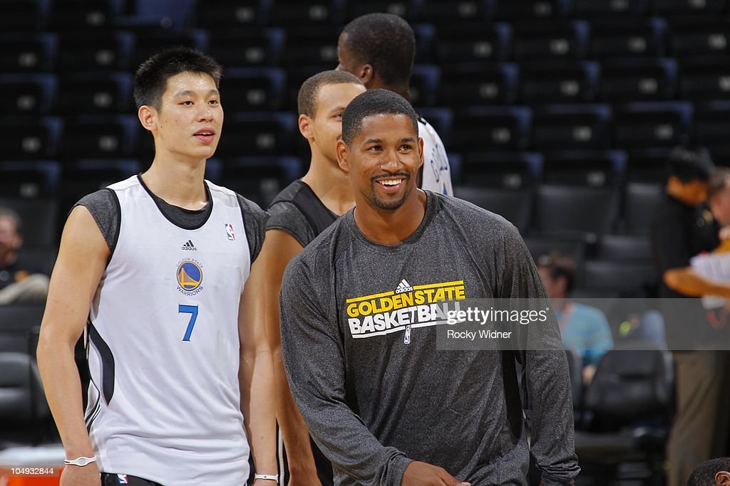 Charlie Bell #34 and Jeremy Lin #7 of the Golden State Warriors smile at the team's annual Open Practice on October 6, 2010 in Oakland, California.