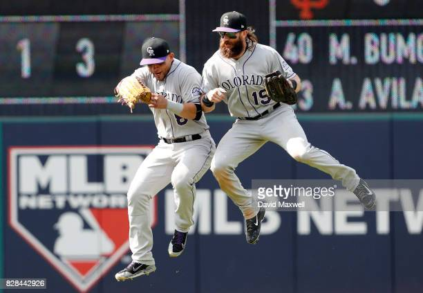 Charlie Blackmon and Gerardo Parra of the Colorado Rockies celebrate after defeating the Cleveland Indians in 12 innings at Progressive Field on...
