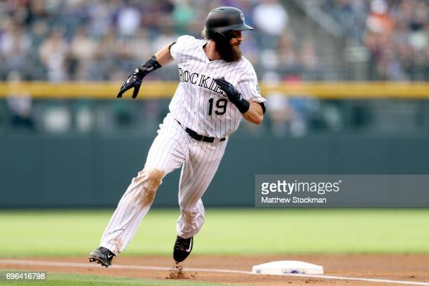 Charlie Blackmon of the Coloarado Rockies rounds thrid base to score on a DJ LeMahieu single in the first inning against the San Francisco Giants at...