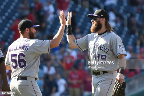 Charlie Blackmon of the Colorado Rockies and Greg Holland celebrate a win after game one of a doubleheader baseball game against the Washington...