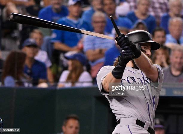 Charlie Blackmon of the Colorado Rockies breaks his bat as he fouls the ball off in the sixth inning against the Kansas City Royals at Kauffman...