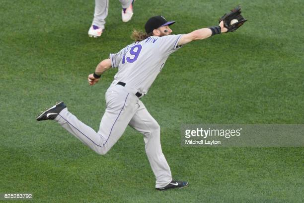 Charlie Blackmon of the Colorado Rockies catches a fly ball during a baseball game against the Washington Nationals at Nationals Park on July 29 2017...