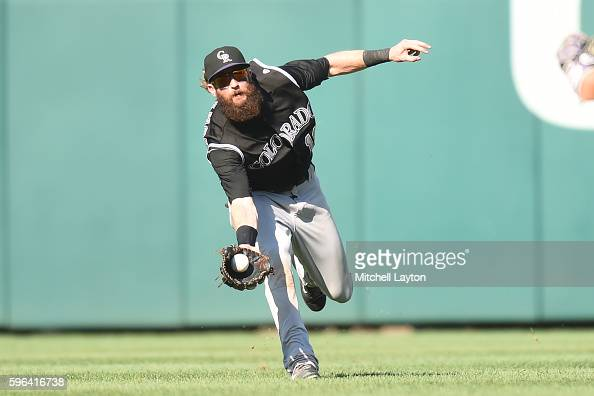 Charlie Blackmon of the Colorado Rockies catches a fly ball hit by Trea Turner of the Washington Nationals in the ninth inning during a baseball game...