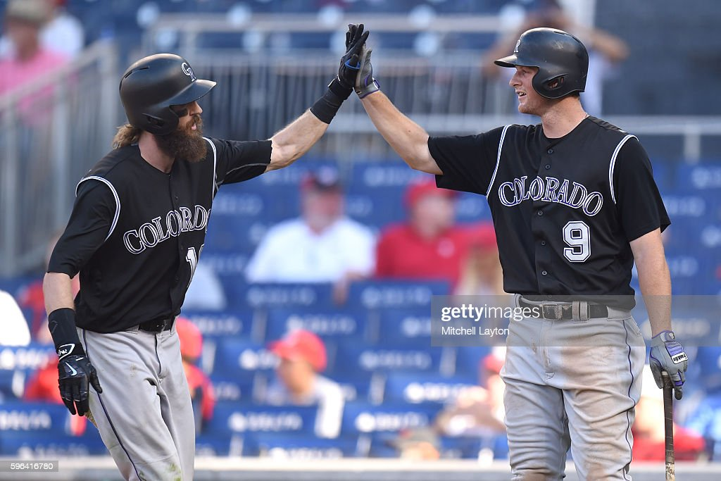 Charlie Blackmon #19 of the Colorado Rockies celebrates hitting a solo home run in the 11th inning with DJ LeMahieu #9 during a baseball game against the Washington Nationals at Nationals Park on August 27, 2016 in Washington, DC.