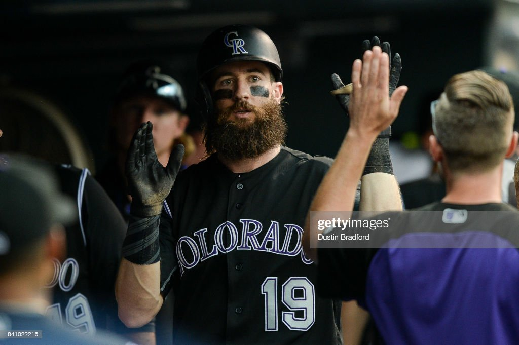 Charlie Blackmon #19 of the Colorado Rockies celebrates in the dugout after hitting a sixth inning solo homerun against the Detroit Tigers at Coors Field on August 30, 2017 in Denver, Colorado.