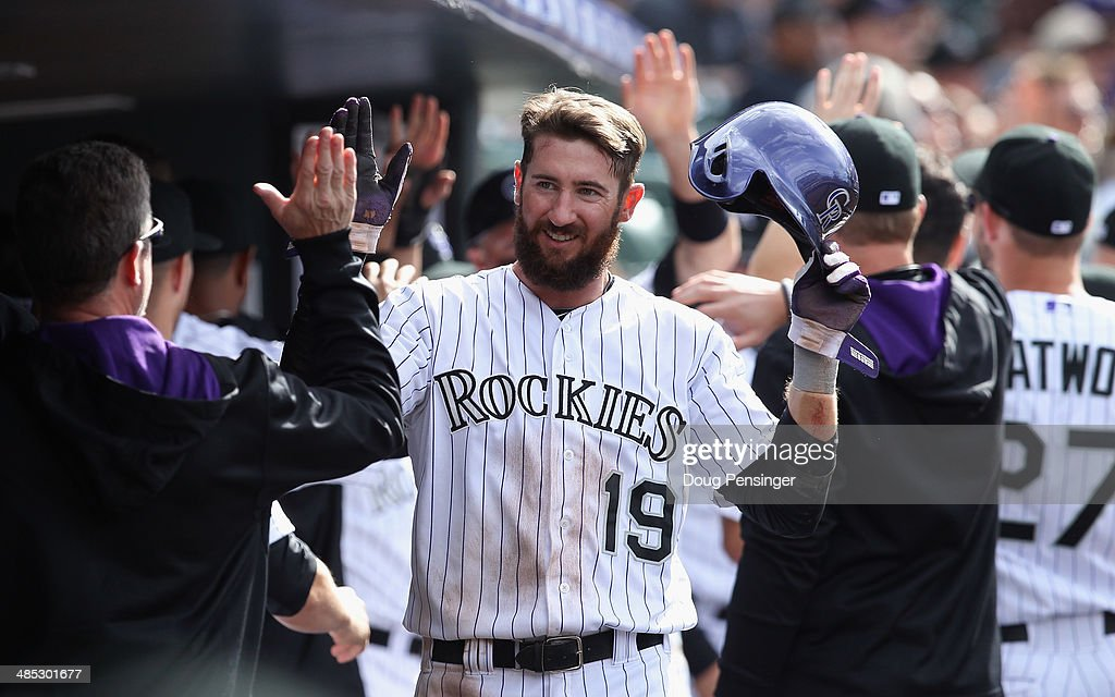 <a gi-track='captionPersonalityLinkClicked' href=/galleries/search?phrase=Charlie+Blackmon&family=editorial&specificpeople=7519880 ng-click='$event.stopPropagation()'>Charlie Blackmon</a> #19 of the Colorado Rockies celebrates in the dugout after scoring against the Chicago White Sox during Interleague play at Coors Field on April 9, 2014 in Denver, Colorado. The Rockies defeated the White Sox 10-4.