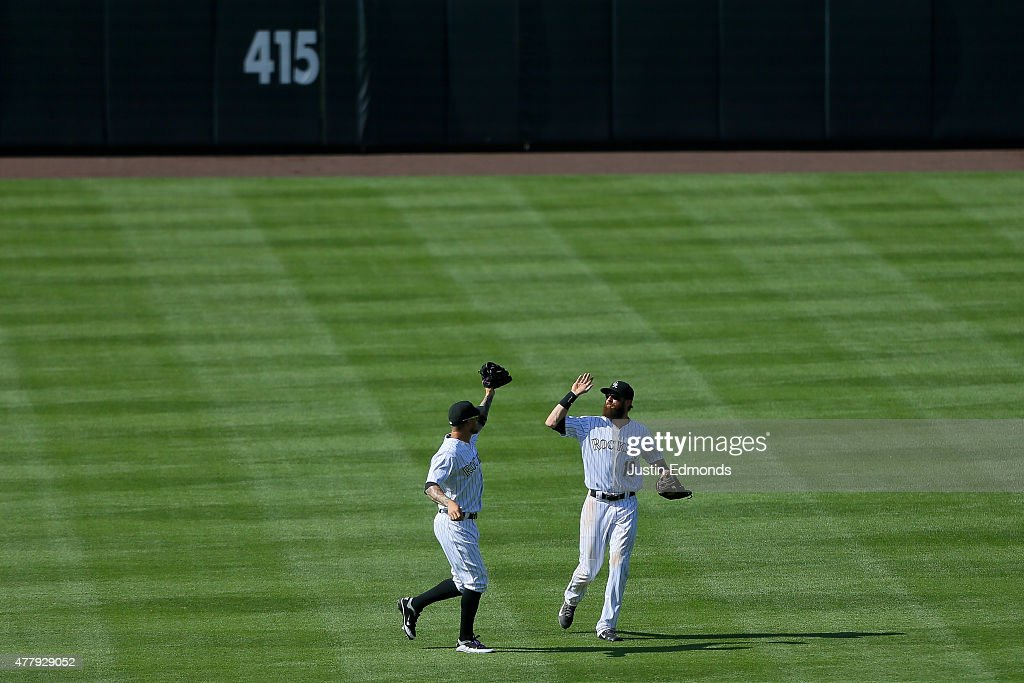 Charlie Blackmon #19 of the Colorado Rockies celebrates with Brandon Barnes #1 after they defeated the Milwaukee Brewers 5-1 at Coors Field on June 20, 2015 in Denver, Colorado.