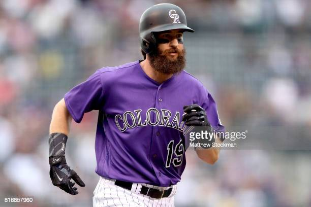 Charlie Blackmon of the Colorado Rockies circles the bases after hitting a home run in the first inning against the San Diego Padres at Coors Field...
